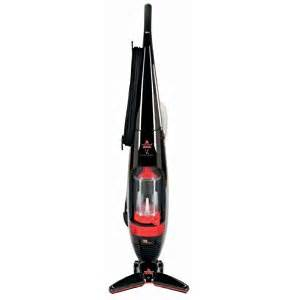 bissell versus bare floor vacuum with brushless v shape technology vacuum it
