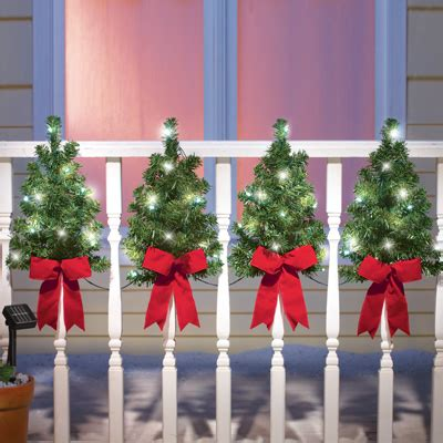 ideas for decorating iron fence posts for christmas solar trees wall fence decor from collections etc