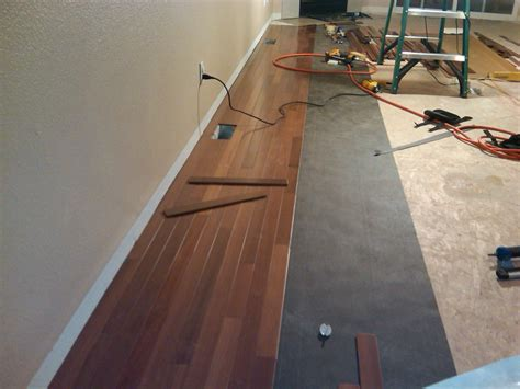 How To Lay A Hardwood Floor by How To Install Wood Floors In Your Living Room Evolving