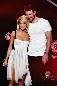 celebrity hunt game song carrie underwood and mike fisher with their 1 yr old son
