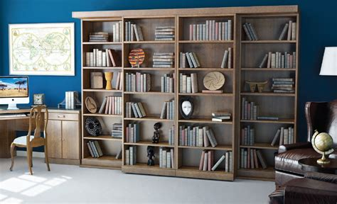 sliding bookcases hide a murphy bed decorating