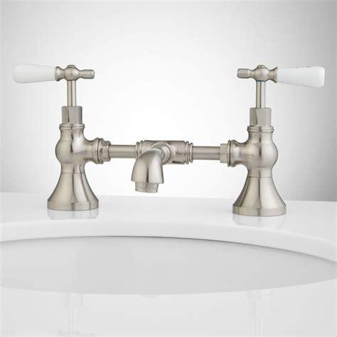 Bridge Bathroom Sink Faucets by Bridge Bathroom Faucet Porcelain Lever Handles