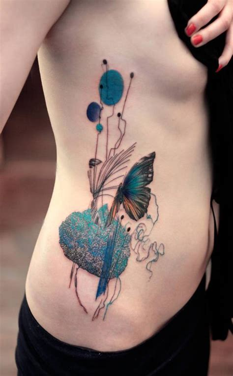 simple side tattoos simple and artistic peacock on rib side