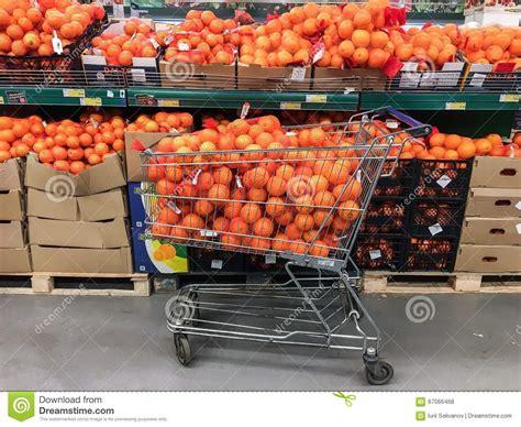 Shelf Of Oranges supermarket cart and shelf of oranges editorial stock