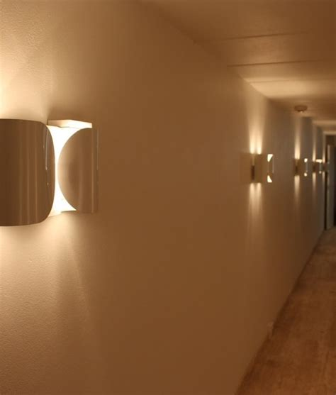 foglio wall light by flos available in three finishes