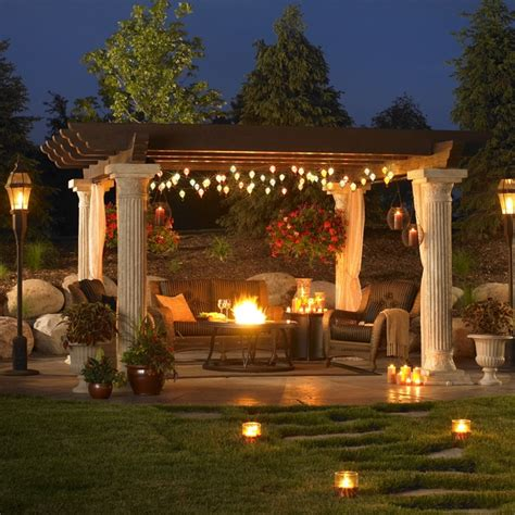 a outdoor patio setup with a pergola by - Outdoor Great Room