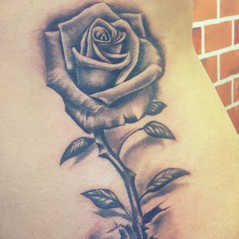 rose growing from concrete tattoo district 73 photos 42 reviews