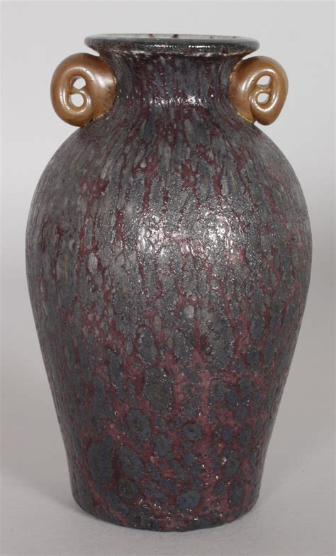 a loetz speckled blue shaped glass vase with redd