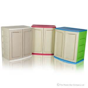 plastic cabinet with shelf and doors