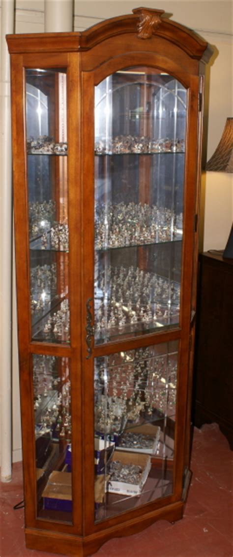 Lighted etched glass front corner curio cabinet / display