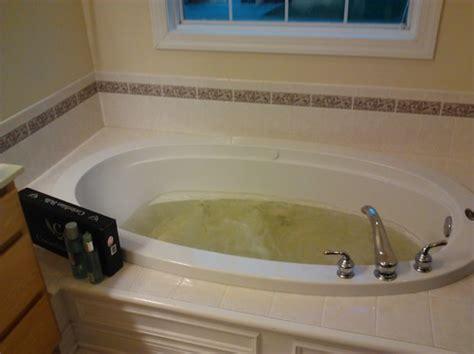 mosaic tile around bathtub quickie bathroom update 1500 00