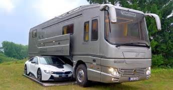 volkner mobil performance this 1 7 million motorhome with its own garage may look