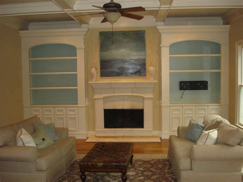 built in cabinets flanking a fireplace decoration