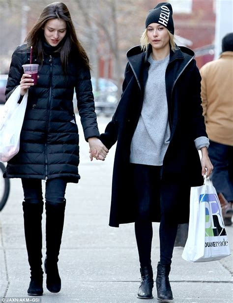hailey baldwin holds hands with gabby westbrook after