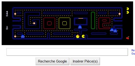 pacman two player logo pacman doodle 21 mai 2010