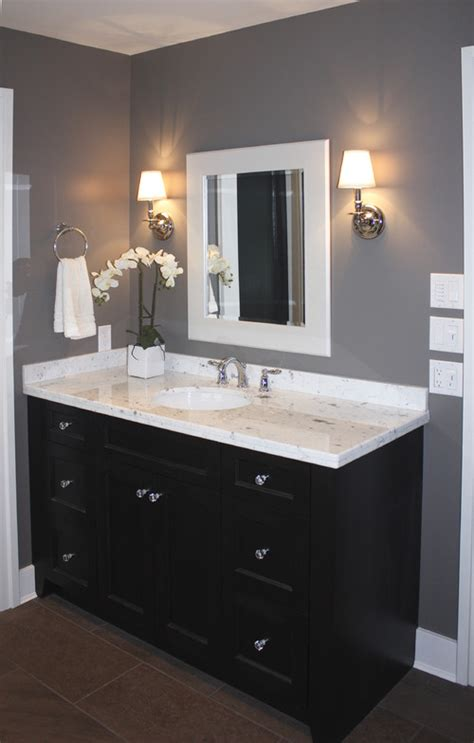 bathrooms with grey walls white framed mirrors bring classic look