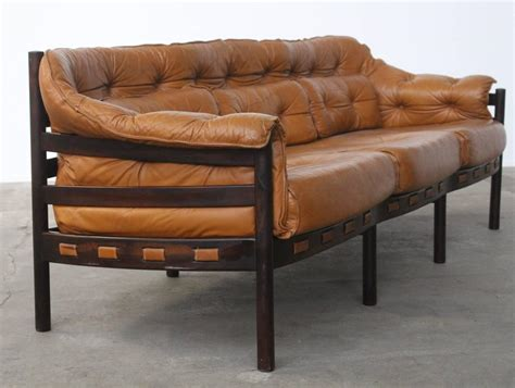 tufted leather camel colored three seat arne norell sofa
