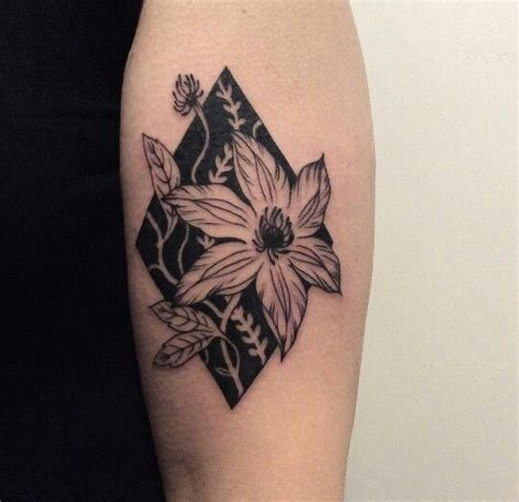 tattoo diamond flower negative space floral diamond tattoo in black ink by
