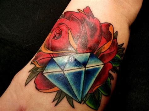 rose and diamond tattoo meaning beautiful and on arm