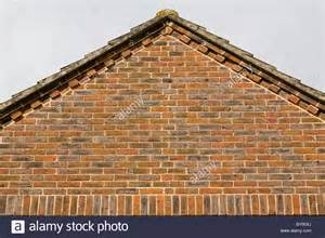 the gable end of a house roof showing brick decorative detail stock photo royalty free image