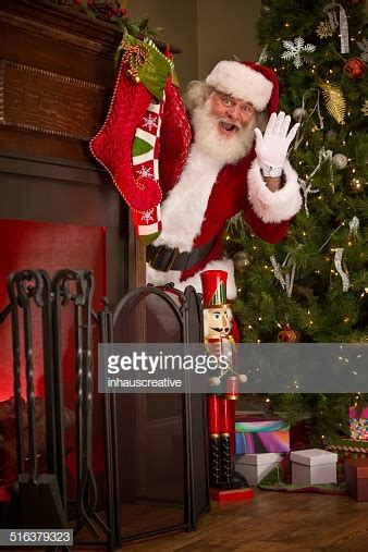 img of santa claus and x mas tree real santa claus hiding tree stock photo getty images