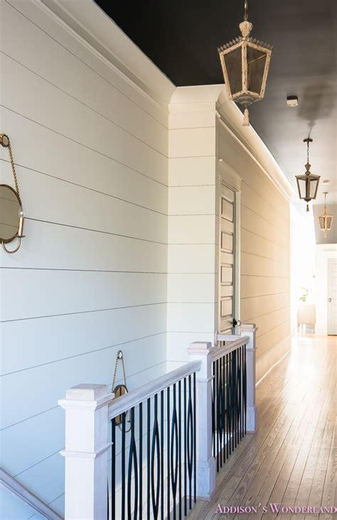 ordinary Grey House With Black Trim #4: hallway-white-walls-shiplap-black-ceiling-alabaster-inkwell-lantern-chateau-blue-door-stardew-uncertain-grey-whitewashed-hardwood-flooring-12-of-15.jpg