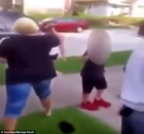 two women fighting in the backyard mother encourages daughter as she fights with another girl