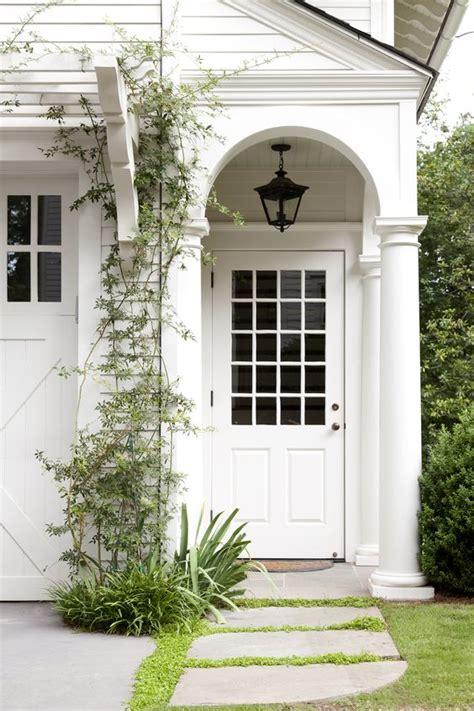 garage door front door porch carriage house entry porch trellis garage doors home exteriors white