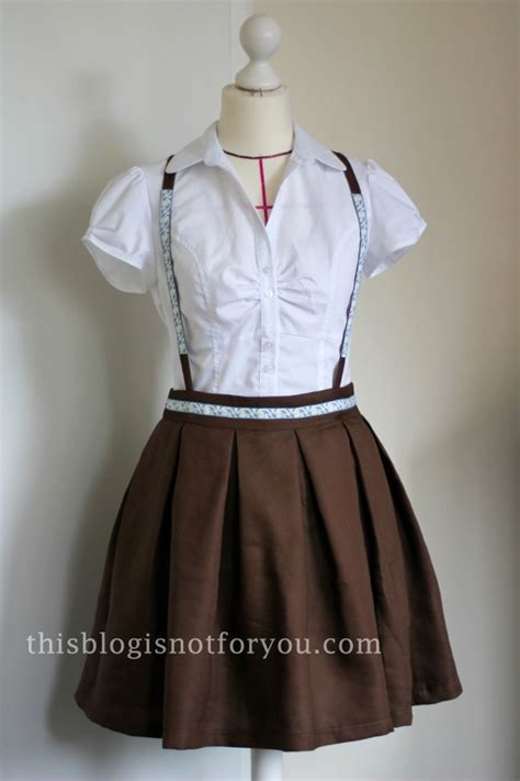 pleated skirt with vintage trim and detachable suspenders