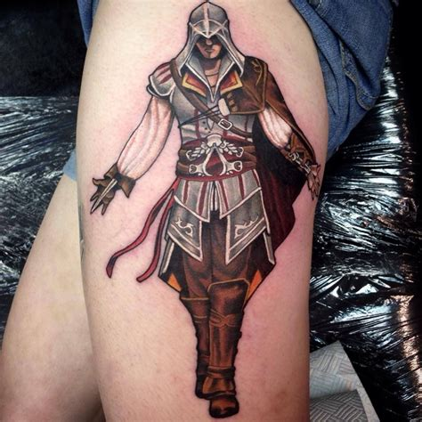 assassins creed tattoo designs assassins creed on leg by paul priestley tattoos