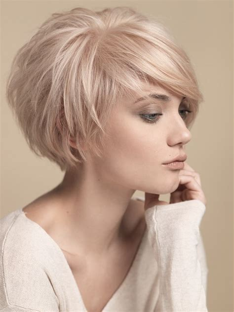 short hair with wispy front and sides short round layers side swept bangs short hair