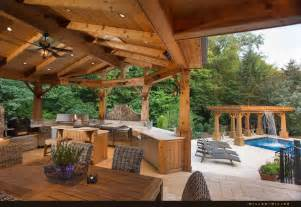 The home features a heated outdoor second kitchen with multiple grills