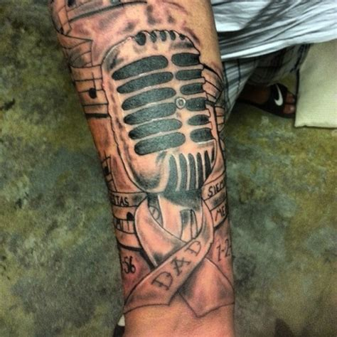 microphone tattoo with music notes mic and ribbon and music notes tattoo picture at