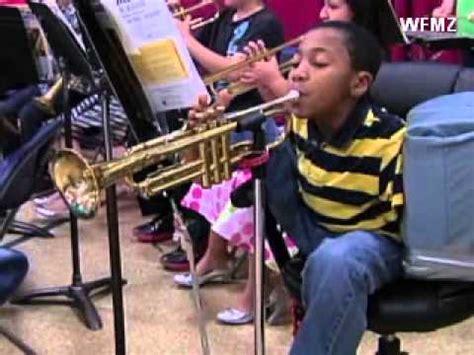 armless  year  boy plays  trumpet   foot