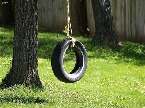 tire swing hanger the brown s had a great old tire swing hanging from their