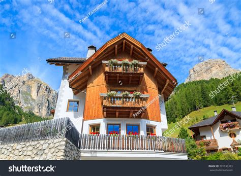traditional alpine house stock photo image of blooming traditional alpine house with flowers on balcony in summer