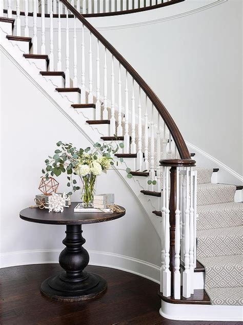Curved Foyer Table table on curved staircase wall traditional entrance foyer