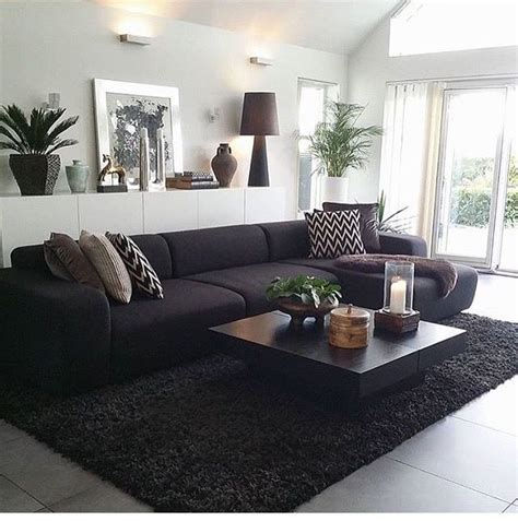 black couch living room dark sofa the 25 best dark sofa ideas on pinterest