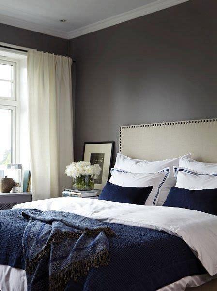 dark blue  white bed  dark walls white curtains