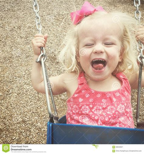 baby swing for 2 year old toddler on swing set stock photo image 58532907