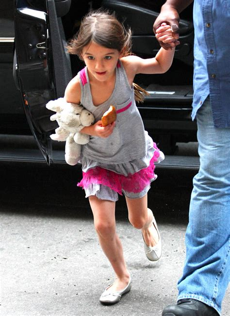 tom and suri cruise win a night at the cinderella castle suite in suri cruise photos tom and suri cruise leave the