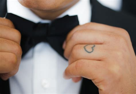 heart tattoo on wedding finger 8 tattoo wedding ring ideas that show your commitment for