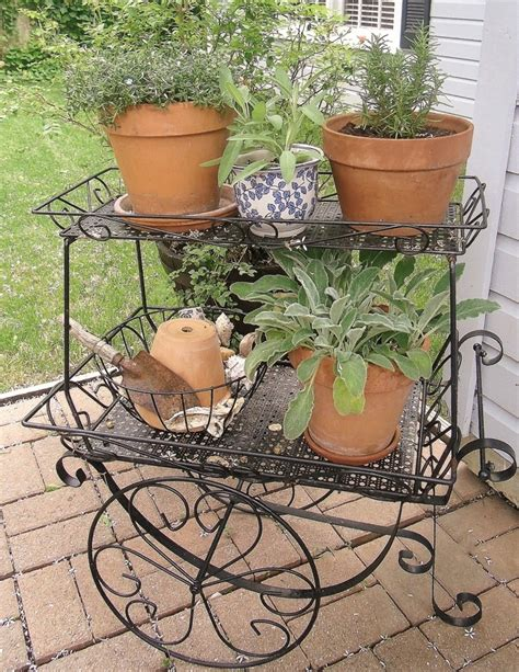 Rod Iron Planters by Wrought Iron Plant Stand Planters Woodworking Projects