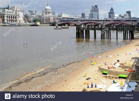 thames river man made low tide sandy beach beside river thames man creating sand