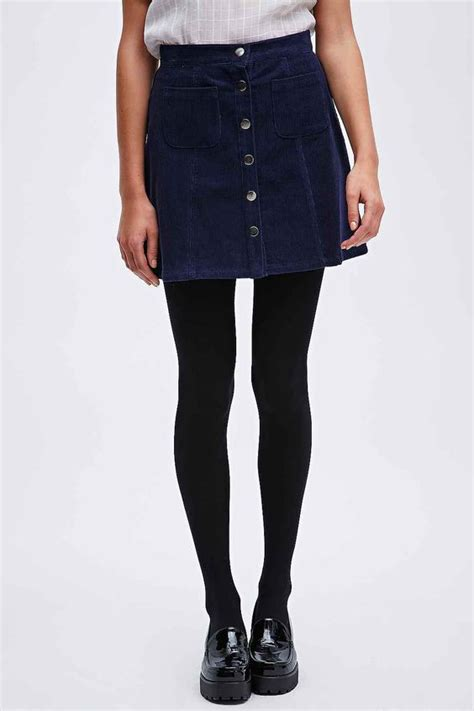 outfitters skirt fashion and opaque tights on