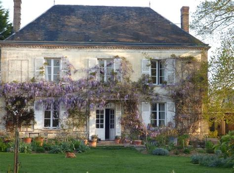 french country house wisteria blooming and fragrant my french country home