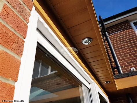 soffits and fascias with brown round guttering