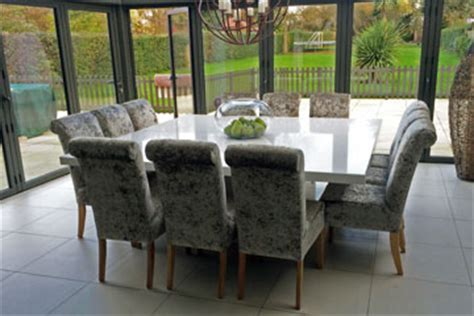 grey dining table with zebra dining chairs transitional