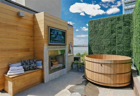 Shower Over Roll Top Bath urban rooftop oasis hot tub fireplace and theater