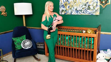 tori spelling s chic and elevated nursery for beau man repeller s leandra medine preps nursery for twins